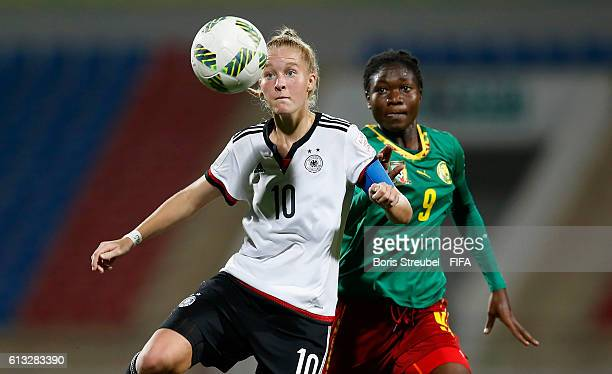 AZ ZARQA' JORDAN OCTOBER 07 Janina Minge of Germany is challenged by Alexandra Takounda of Cameroon during the FIFA U17 Women's World Cup Group B...