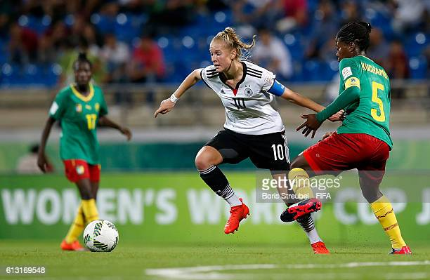 AZ ZARQA' JORDAN OCTOBER 07 Janina Minge of Germany is challenged by Eni Kuchambi of Cameroon during the FIFA U17 Women's World Cup Group B match...