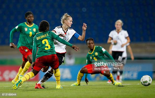 AZ ZARQA' JORDAN OCTOBER 07 Janina Minge of Germany is challenged by players of Cameroon during the FIFA U17 Women's World Cup Group B match between...
