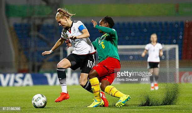 AZ ZARQA' JORDAN OCTOBER 07 Janina Minge of Germany is challenged by Viviane Mefire of Cameroon during the FIFA U17 Women's World Cup Group B match...