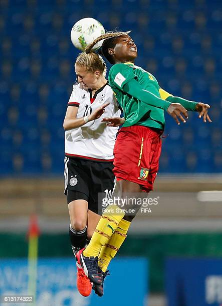 AZ ZARQA' JORDAN OCTOBER 07 Janina Minge of Germany jumps for a header with a player of Cameroon during the FIFA U17 Women's World Cup Group B match...