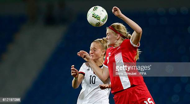 Janina Minge of Germany jumps for a header with Hannah Taylor of Canada during the FIFA U17 Women's World Cup Jordan Group B match between Germany...