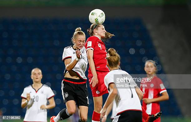 Janina Minge of Germany jumps for a header with Marika Guay of Canada during the FIFA U17 Women's World Cup Jordan Group B match between Germany and...