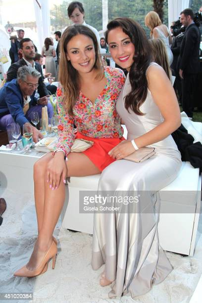 Janina Uhse and Nina Moghaddam attend the Raffaello Summer Day 2014 at Kronprinzenpalais on June 21 2014 in Berlin Germany