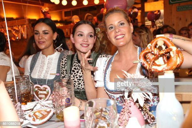 Janina Uhse Emilia Schuele and Anika Decker at the 'Madlwiesn' event during the Oktoberfest at Theresienwiese on September 21 2017 in Munich Germany