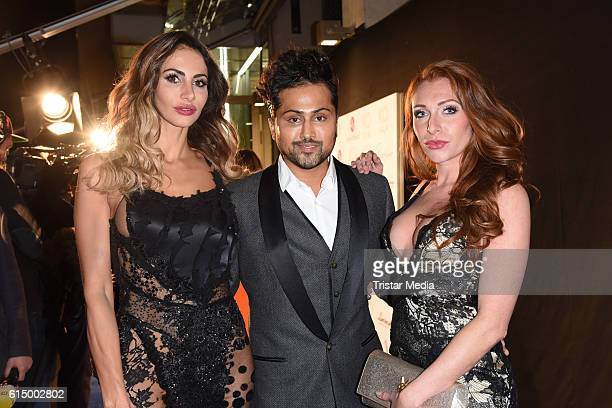 Janina Youssefian Samuel Sohebi and Georgina Fleur Buelowius attend the Opening Party of the Men's Beauty Clinic on October 15 2016 in Duesseldorf...