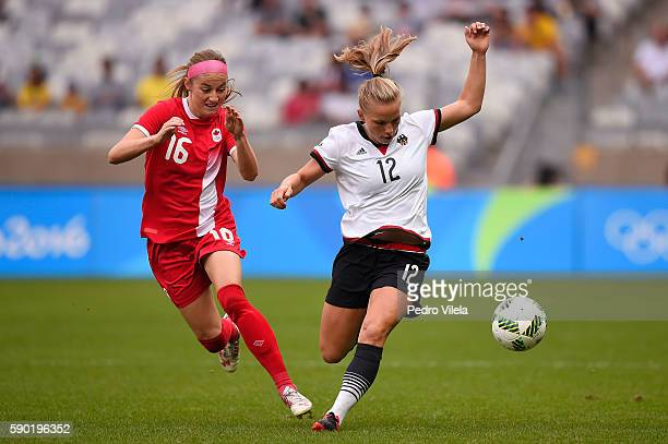 Janine Beckie of Canada and Tabea Kemme of Germany compete for the ball during the Women's Semi Final match between Germany and Canada on Day 11 of...