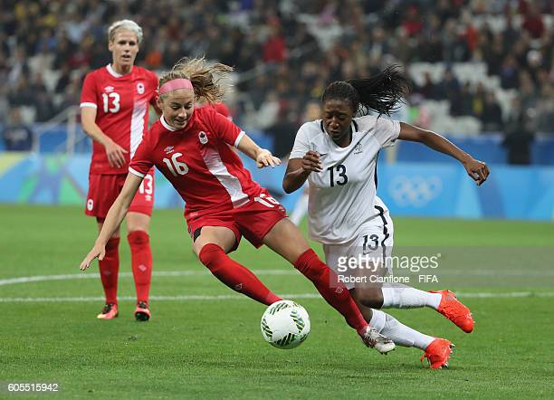 Janine Beckie of Canada challneges Diani Kadidiatou of France during the Women's Football Quarter Final match between Canada and France on Day 7 of...