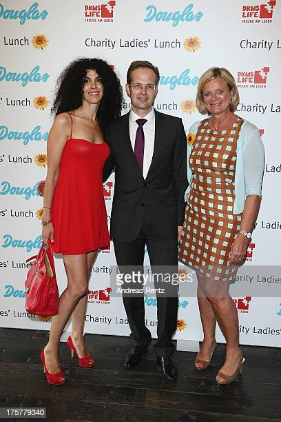 Janine C White Manfred Kroneder and Claudia Rutt attend the DKMS LIFE Charity Ladies lunch at Soho House on August 8 2013 in Berlin Germany