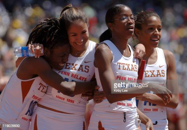 Janine Davis Dee Dee Cortez Katara Rosby and Temika Kincy of Texas celebrate after victory in the College Championship of America women's 4 x...