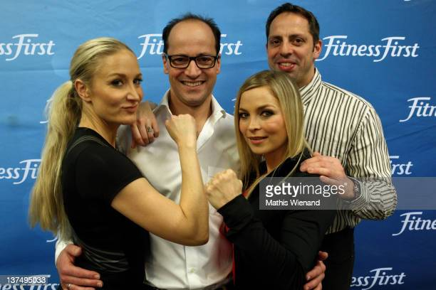 Janine Kunze Stefan Tilk Regina Halmich and Mark Warnecke pose during the Opening at Fitness First Platinum Club MyZeil on January 21 2012 in...