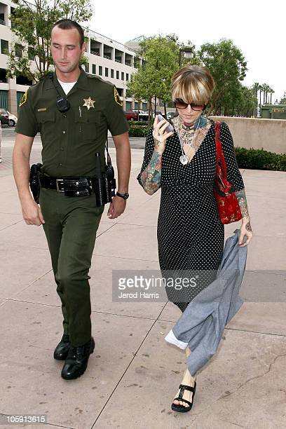 Janine Lindemulder is escorted into the Lamoreaux Justice Center by Orange County Sheriff Deputies after a confronting photographer on October 21...