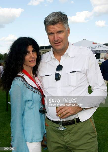 Janine White and her partner Andreas Reuter attend the Engel Voelkers Berlin Maifeld Cup near Olympic Stadium on August 12 2012 in Berlin Germany