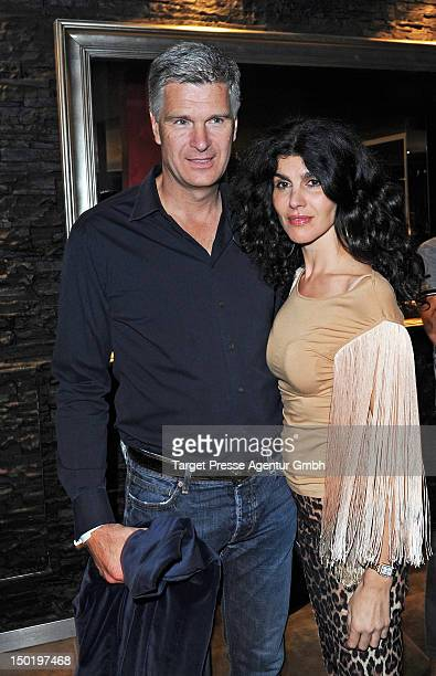 Janine White and partner Andreas Ruter attend players night of the Engel Voelkers Berlin Maifeld cup on August 11 2012 in Berlin Germany