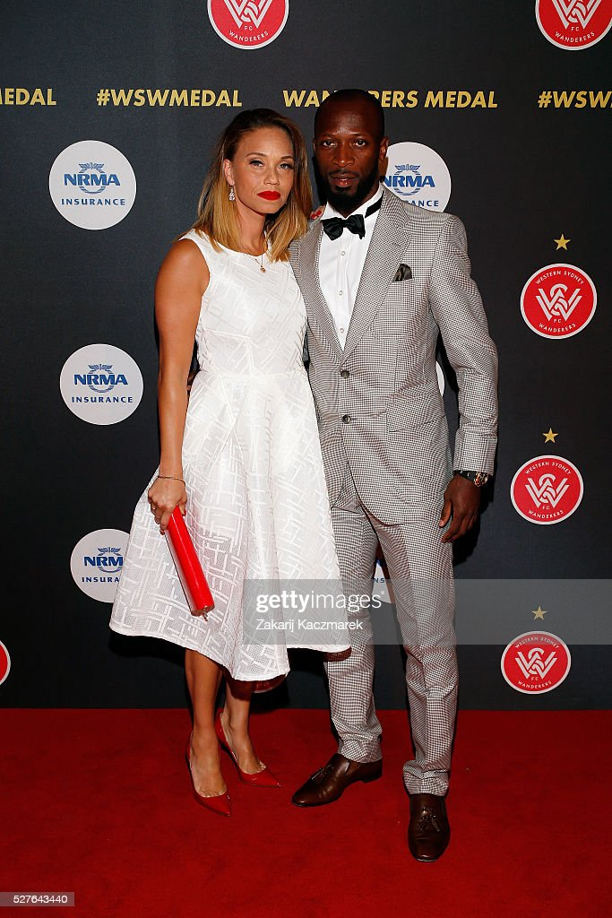 Janis and Romeo Castelen arrive during the 2016 Western Sydney Wanderers Awards at Qudos Bank Arena on May 3, 2016 in Sydney, Australia.