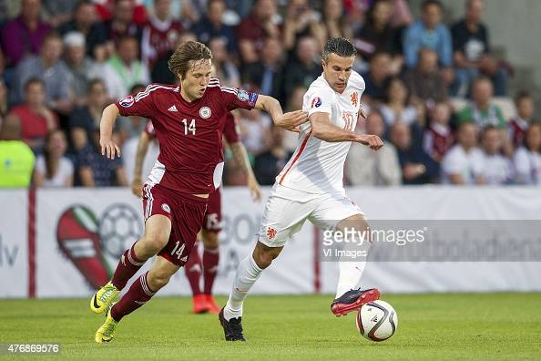 Janis Ikaunieks of Latvia Robin van Persieof Holland during the UEFA EURO 2016 qualifying match between Latvia and The Netherlands on June 12 2015 at...