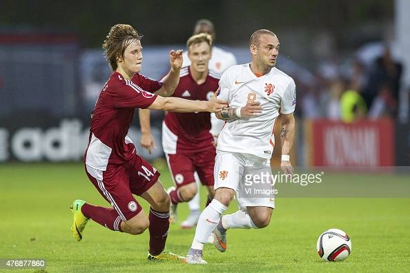 Janis Ikaunieks of Latvia Wesley Sneijder of Holland during the UEFA EURO 2016 qualifying match between Latvia and The Netherlands on June 12 2015 at...