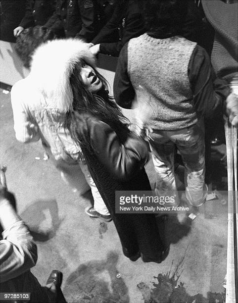 Janis Joplin talks to a fan at a Rolling Stones concert in Madison Square Garden
