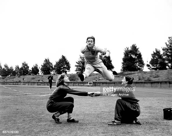 Janis Long jumps over her team mates arms LR Ivy Eden Betty Lovell