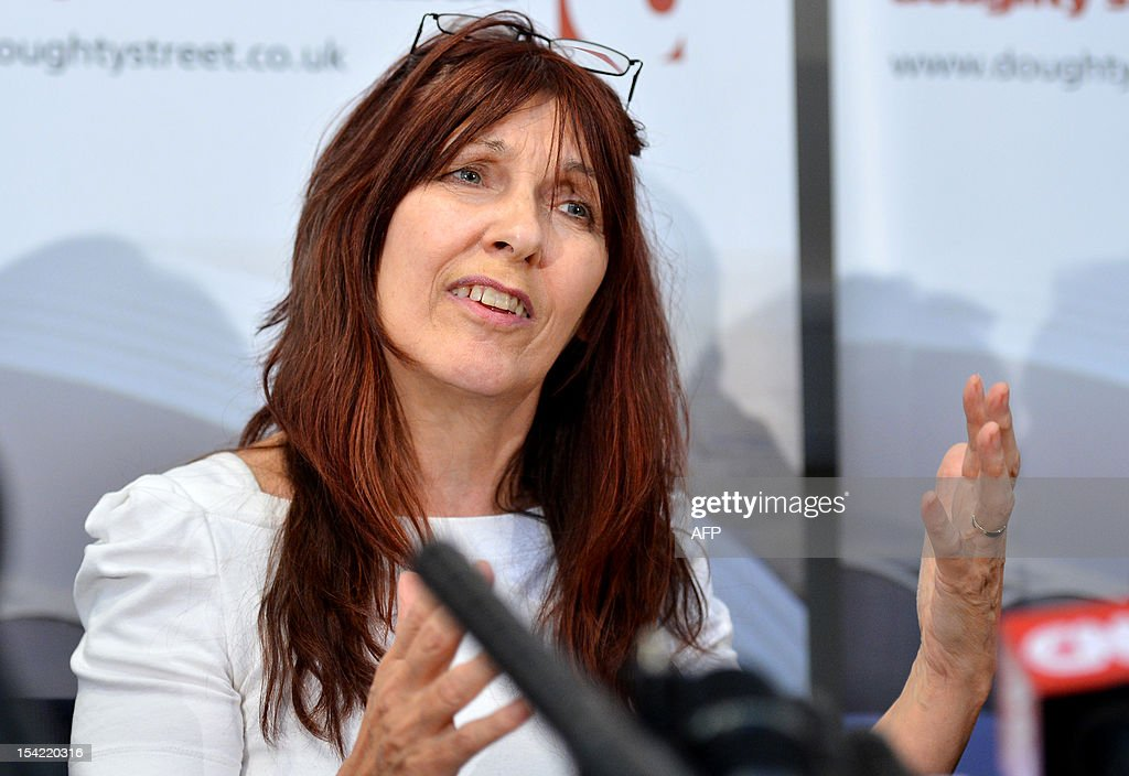 Janis Sharp, mother of hacker Gary McKinnon, an Asperger's sufferer who broke into US military computers and who has fought a decade-long fight against extradition, speaks during a press conference in London on October 16, 2012. Theresa May, British Home Secretary, said extradition would breach 46-year-old McKinnon's human rights as his psychiatrists believed there was a high risk that he would attempt suicide were he sent to the United States. AFP PHOTO/BEN STANSALL