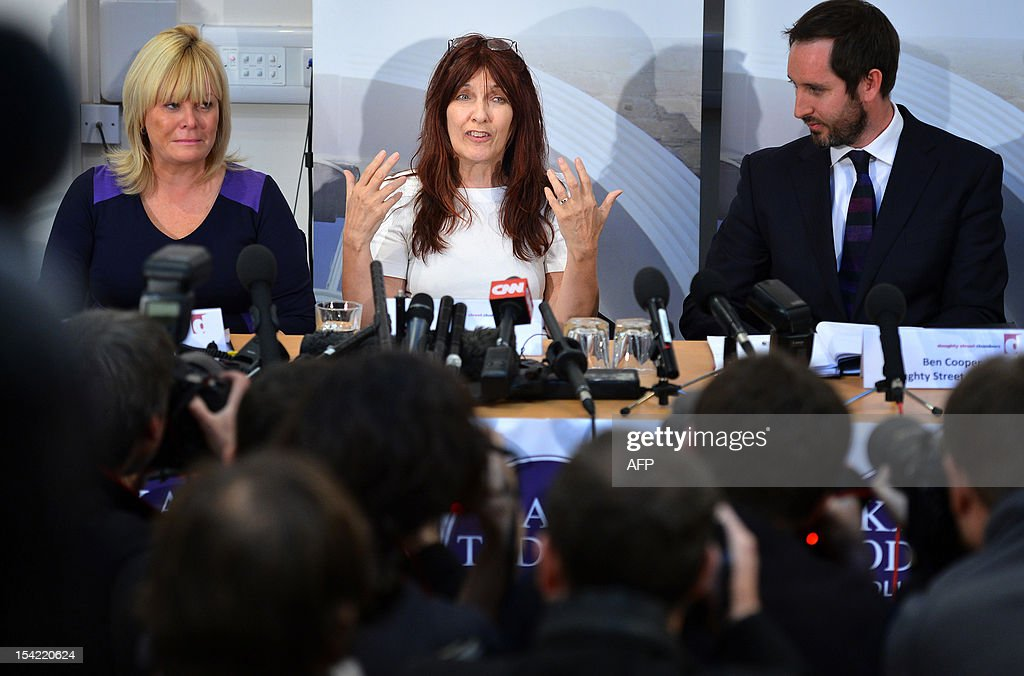 Janis Sharp (C), mother of hacker Gary McKinnon, an Asperger's sufferer who broke into US military computers and who has fought a decade-long fight against extradition, speaks during a press conference in London on October 16, 2012. Theresa May, British Home Secretary, said extradition would breach 46-year-old McKinnon's human rights as his psychiatrists believed there was a high risk that he would attempt suicide were he sent to the United States. AFP PHOTO/BEN STANSALL