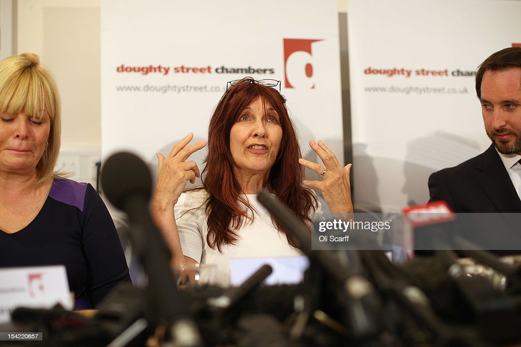 Janis Sharp (C), the mother of British computer hacker Gary McKinnon, becomes emotional during a press conference following a decision by Home Secretary Theresa May not to extradite Mr McKinnon to the US on October 16, 2012 in London, England. Mr McKinnon, who sufferers from Asperger''s Syndrome, admits to accessing US Government computers but claims he was looking for evidence of UFOs. Mrs May told MPs in the House of Commons that Mr McKinnon was 'seriously ill' and that enforcing the extradition warrant would be in breech of his human rights.
