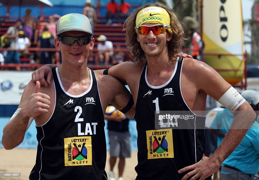 Janis Smedins (L) and Aleksandrs Samoilovs (R) of Latvia after winning the Men's second semi-final between Bruno Oscar Schmidt and Pedro Solberg Salgado of Brazil and Aleksandrs Samoilovs and Janis Smedins of Latvia at the FIVB Durban Open at New Beach on December 14, 2013 in Durban, South Africa.
