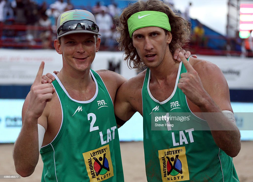 Janis Smedins (L) and Aleksandrs Samoilovs (R) of Latvia pose after winning the Men's final between Aleksandrs Samoilovs and Janis Smedins of Latvia and Martins Plavins and Aleksandrs Solovejs of Latvia at the FIVB Durban Open at New Beach on December 14, 2013 in Durban, South Africa.