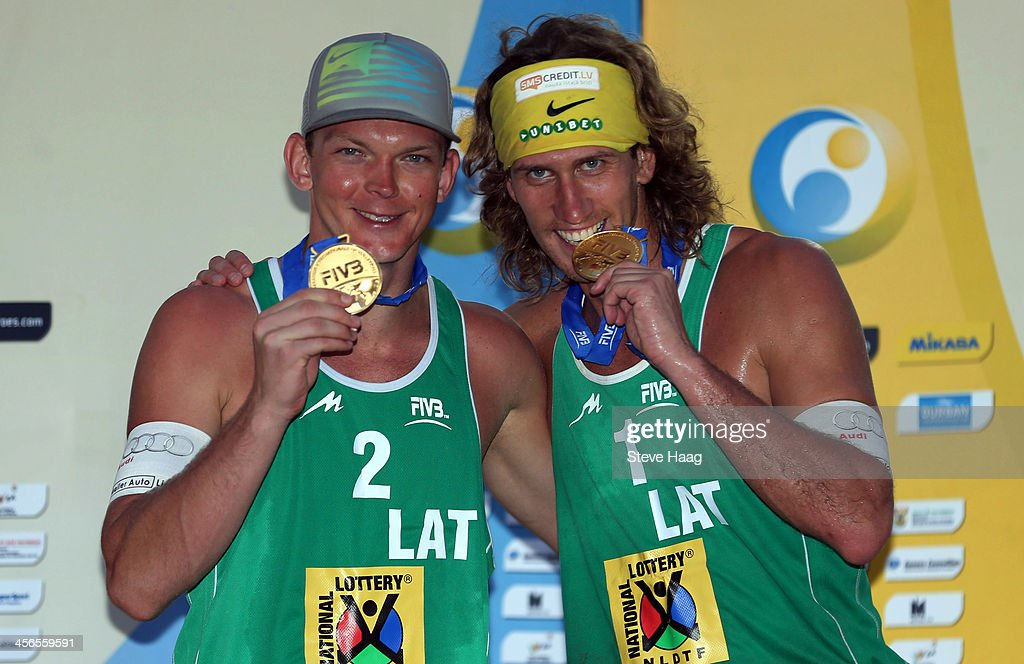 Janis Smedins (L) and Aleksandrs Samoilovs of Latvia pose during the medals ceremony at the FIVB Durban Open at New Beach on December 14, 2013 in Durban, South Africa.