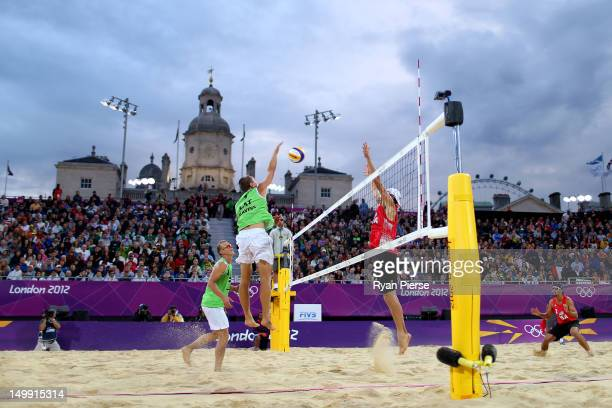 Janis Smedins and Martins Plavins of Latvia return against Jacob Gibb and Sean Rosenthal of the United States during the Men's Beach Volleyball...