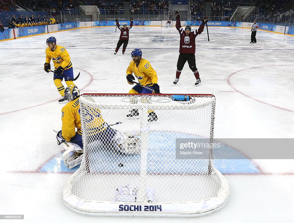Janis Sprukts #5 of Latvia celebrates after scoring against Henrik Lundqvist #30 of Sweden in the second period during the Men's Ice Hockey Preliminary Round Group C game on day eight of the Sochi 2014 Winter Olympics at Shayba Arena on February 15, 2014 in Sochi, Russia.
