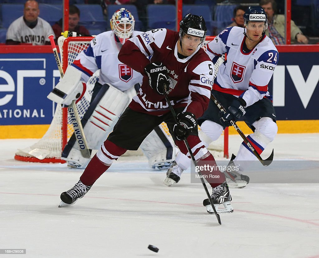 <a gi-track='captionPersonalityLinkClicked' href=/galleries/search?phrase=Janis+Sprukts&family=editorial&specificpeople=638709 ng-click='$event.stopPropagation()'>Janis Sprukts</a> of Latvia skates with the puck during the IIHF World Championship group H match between Russia and France at Hartwall Areena on May 9, 2013 in Helsinki, Finland.
