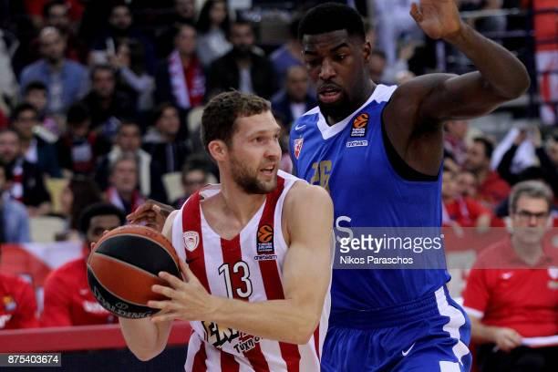 Janis Strelnieks #13 of Olympiacos Piraeus competes with Mathias Lessort #26 of Crvena Zvezda mts Belgrade during the 2017/2018 Turkish Airlines...