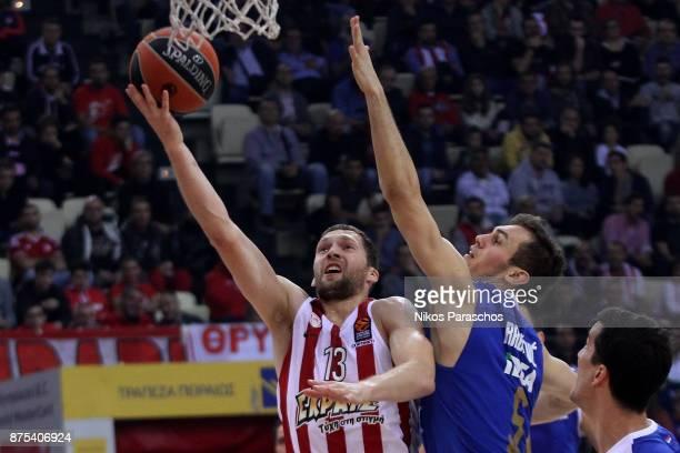 Janis Strelnieks #13 of Olympiacos Piraeus competes with Nikola Radicevic #5 of Crvena Zvezda mts Belgrade during the 2017/2018 Turkish Airlines...
