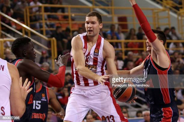 Janis Strelnieks #13 of Olympiacos Piraeus in action during the 2017/2018 Turkish Airlines EuroLeague Regular Season Round 1 game between Olympiacos...