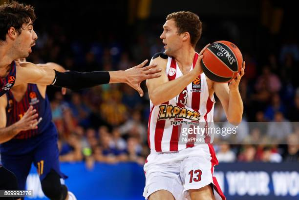 Janis Strelnieks and Ante Tomic during the match between FC Barcelona v Olympiakos BC corresponding to the week 5 of the basketball Euroleaguein...