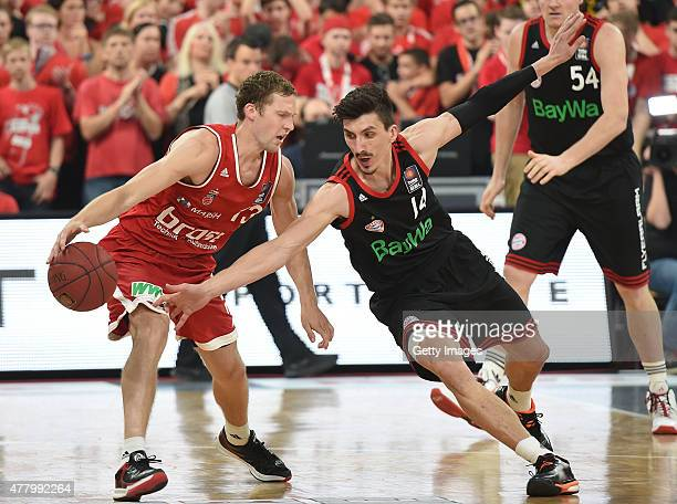 Janis Strelnieks of Brose Baskets Bamberg under pressure from Nihad Dedovic of FC Bayern Muenchen during Game Five of the 2015 BBL Finals at Brose...