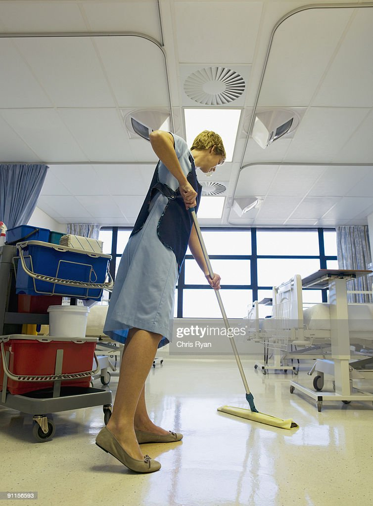 Janitor cleaning hospital room : Stock Photo