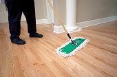 Janitor Dusting Hardwood Floor