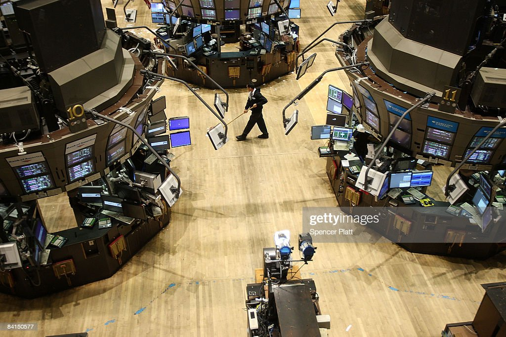 A janitor sweeps an empty trading floor at the New York Stock Exchange (NYSE) December 31, 2008 in New York City. Wednesday is the last day of trading on the exchange in what has been one of the most tumultuous years in finance in the nation's history.