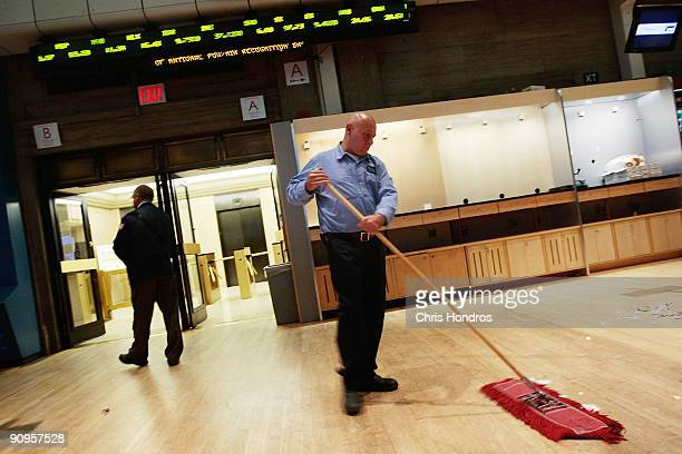 A janitor sweeps up the floor of the New York Stock Exchange near the end of the trading day September 18 2009 in New York City Stocks closed...