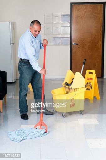 Janitorial Service - Maintenance Man Cleaning Office Floor