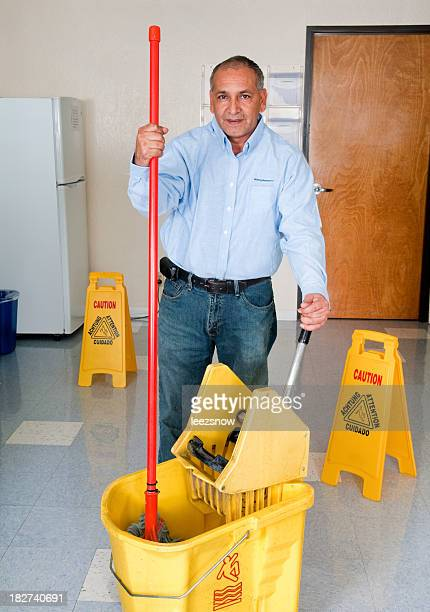 Janitorial Services - Maintenance Man Cleaning Office Floor