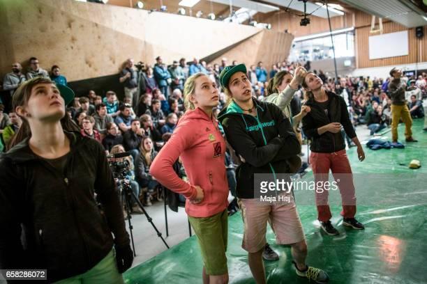 Janja Garnbret of Slovenia and Stasa Gejo of Serbia observe the boulder problem prior finals of bouldering event Studio Bloc Masters 2017 on March 26...