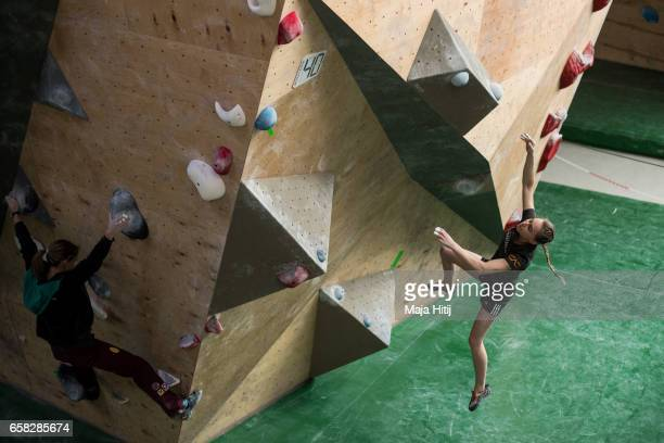 Janja Garnbret of Slovenia falls down as she warms up prior women semi finals of bouldering event Studio Bloc Masters 2017 on March 26 2017 in...