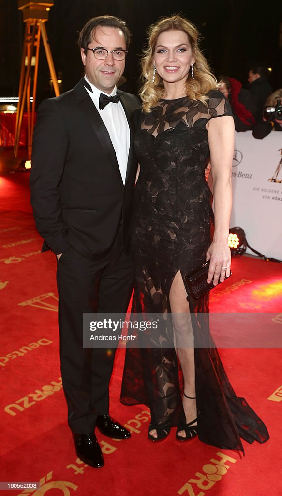Jan-Josef Liefers and Anna Loos attend 'Goldene Kamera 2013' at Axel Springer Haus on February 2, 2013 in Berlin, Germany.
