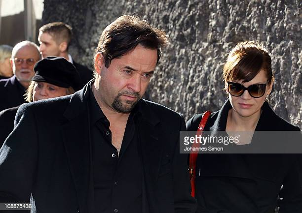 JanJosef Liefers and Anna Loos attend the memorial service for Bernd Eichinger at the St Michael Kirche on February 07 2011 in Munich Germany...