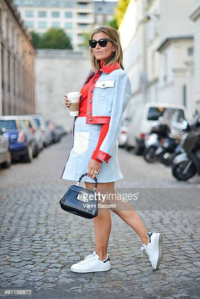 Janka Polliani poses wearing Fendi jacket and skirt Max Mara pull Gucci bag and Adidas shoes before the Rahul Mishra show at the Mona Bismarck...