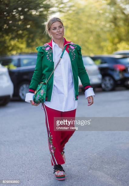 Janka Polliani wearing a green Gucci bag and jacket with the print Hollywood outside Saks Potts on August 10 2017 in Copenhagen Denmark