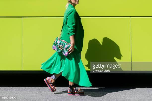 Janka Polliani wearing Miu Miu shoes Gucci bag green coat outside Cala Jade on August 23 2017 in Oslo Norway